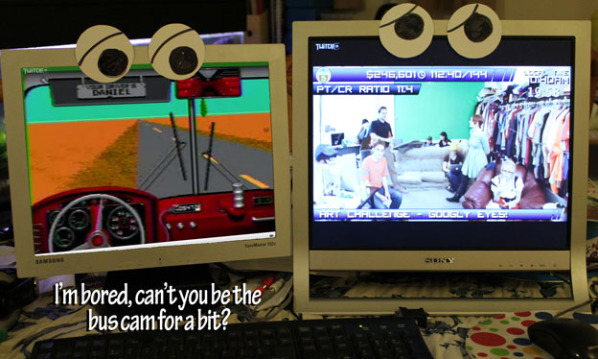 """Two computer screens with eyes showing feeds from Desert Bus 5. Bus cam says to driver cam, """"I'm bored, can't you be the bus cam for a while?"""""""