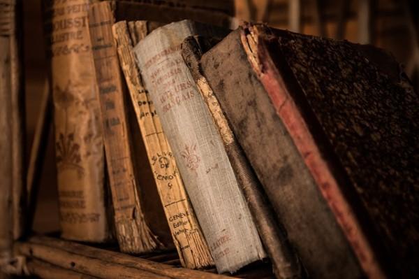 Old, dusty Books On a Bookshelf