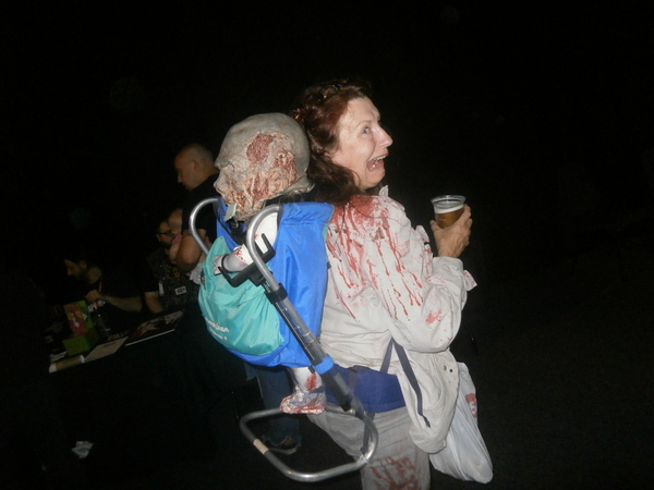 Cosplay costume with a zombie in a backpack