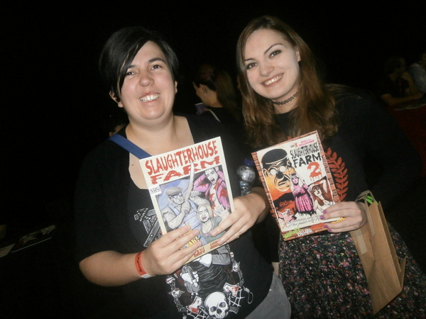 Fans with copies of Slaugherhouse Farm comic