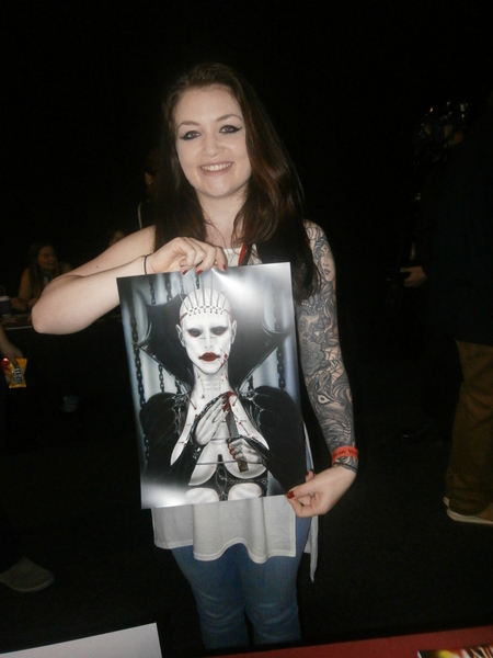 A fan picks up a Hellraiser-inspired print by artist Anna Susanne