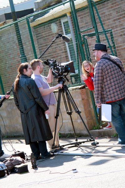 Filming a scene from the Carnival of Sorrows. Pictured L-R: Barry Davis (boom, off-camera), Mark Adams (Director), Felek Werpachowski (camera and DP), Antonia Tootill (Jenny Marwick), Matt Warner (Script Editor and Production Assistant)