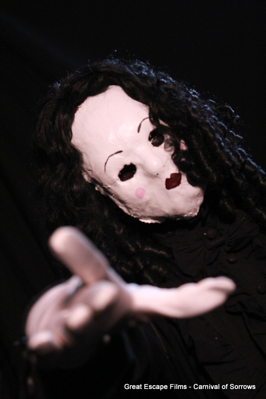 Woman in a doll face mask
